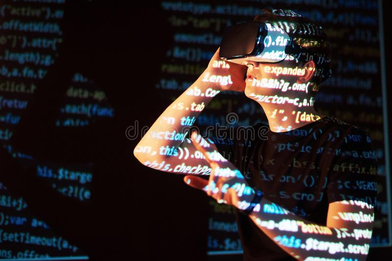 Double exposure of a caucasian man and Virtual reality headset is presumably a gamer or a hacker cracking the code into royalty free stock photography