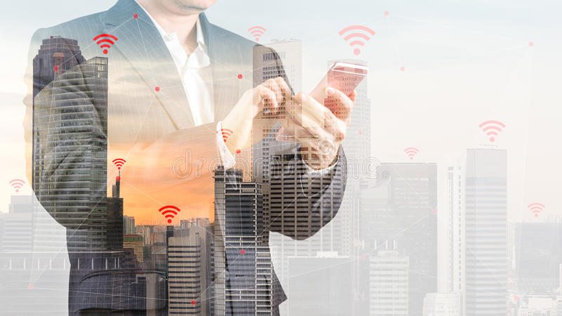 Double Exposure of City Background with Businessman in Suit Using Smartphone Illustrating Wireless Connection and Internet stock photos