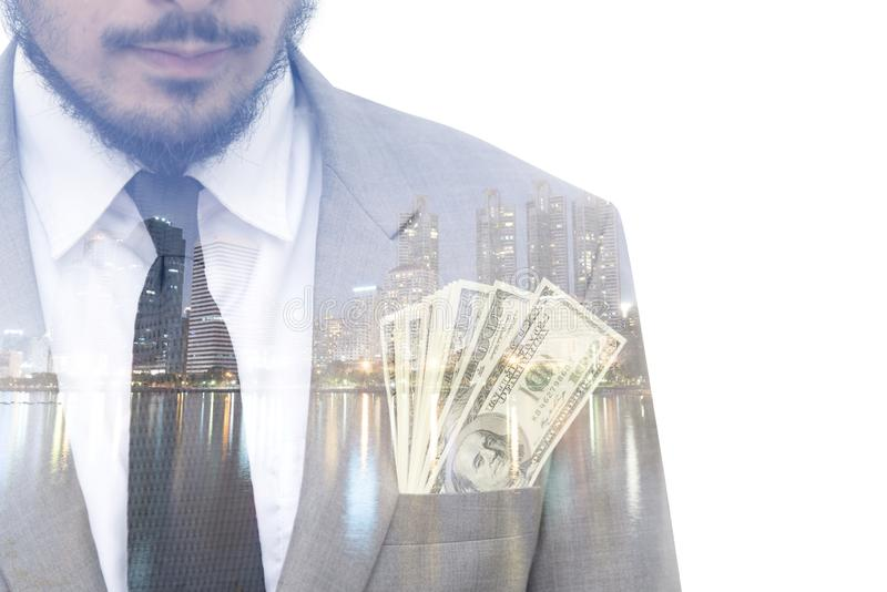 Double exposure of city and businessman with a lot of money royalty free stock images