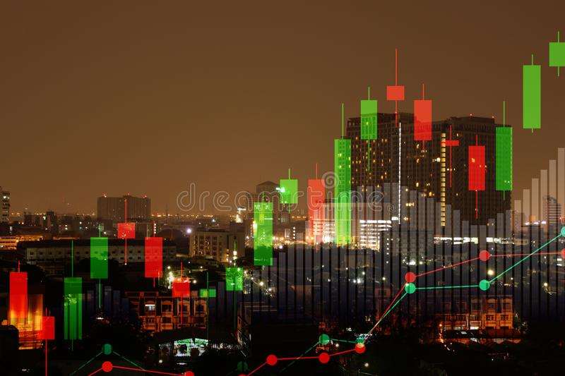 Double exposure of cityscape and stock market or financial graph for financial investment concept stock image
