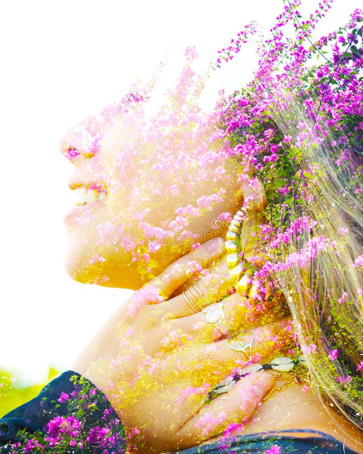 Double exposure close up profile portrait of a young pretty woman interwoven with bright purple Bougainvillea flowers seemingly stock photos