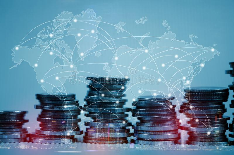 Double exposure of coin stack with city background and world map. Financial graph, world map and global network business concept idea, element by NASA stock photos