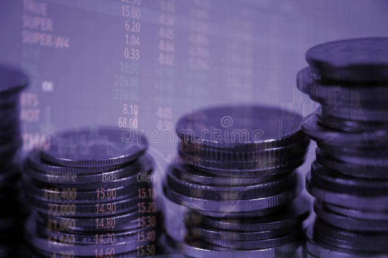 Double exposure of coin stack with stock market screen chart boa. Rd and candle stick for financial business and investor analysis concept idea stock photo