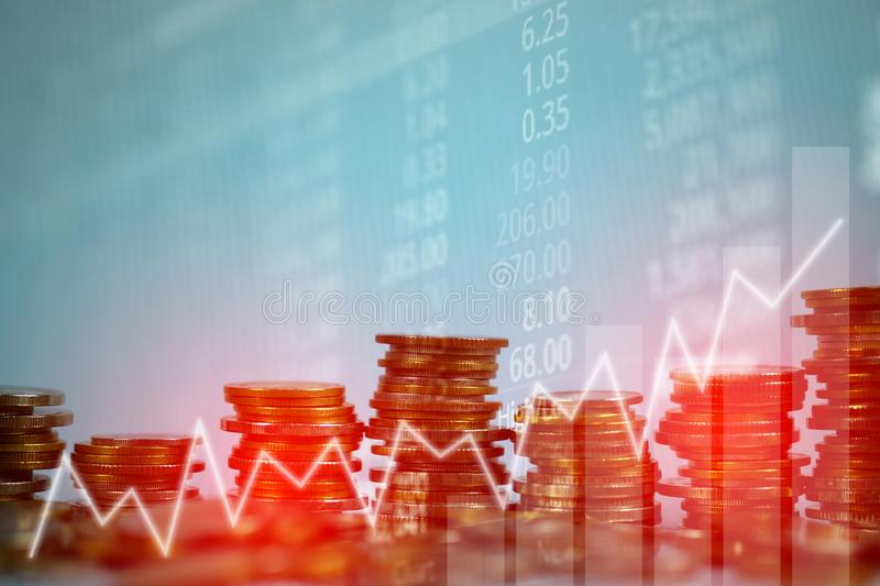 Double exposure of coin stack with stock market screen chart boa stock photography