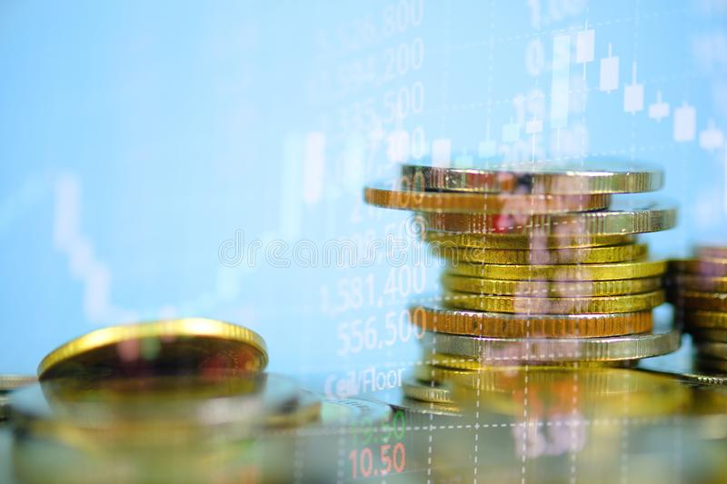 Double exposure of coin stack with stock market screen chart boa. Rd and candle stick for financial business and investor analysis concept idea stock photography