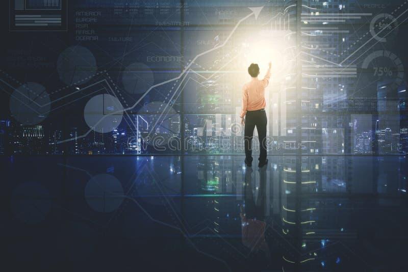 Male entrepreneur touching virtual button royalty free stock image
