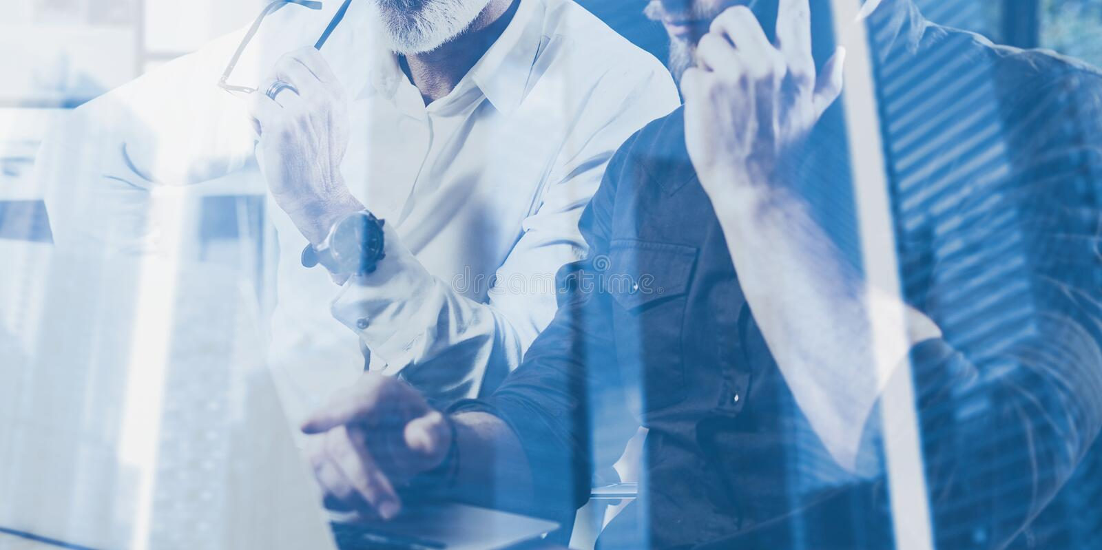 Double exposure concept.Team of business people making great work discussion.Two bearded coworkers working with mobile. Gadgets.Skyscraper office building royalty free stock image