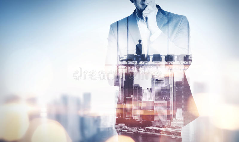 Double exposure concept with thinking businessman and city. With royalty free stock photos