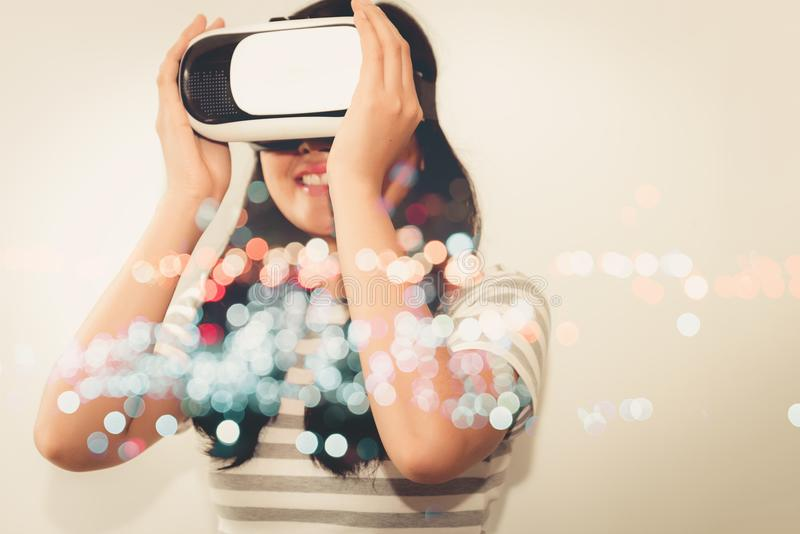 Double exposure concept of young woman is playing virtual realit. Y goggles stock photos