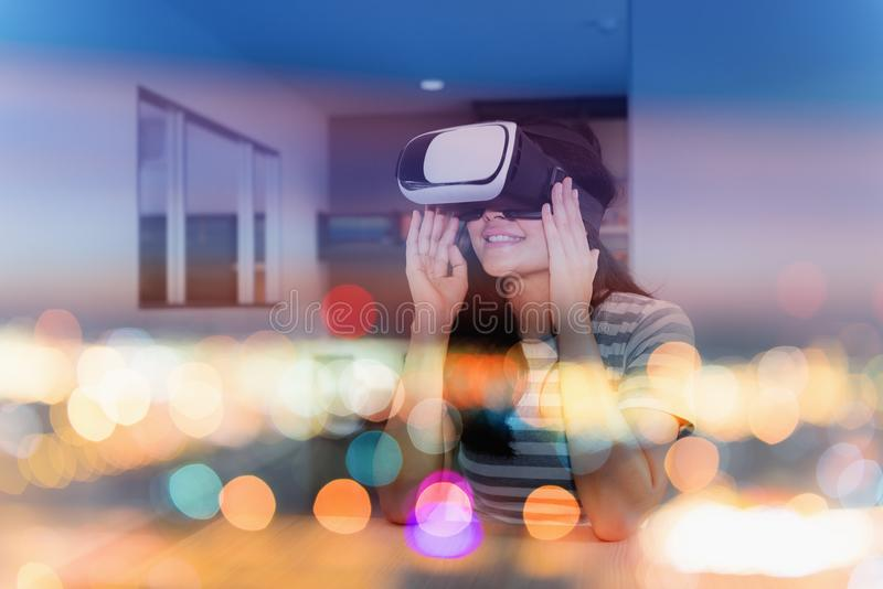 Double exposure concept of young woman playing virtual reality g stock photography