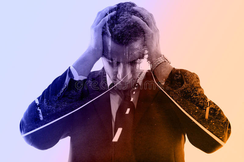 Double exposure of depressed business man and road in nature royalty free stock photography