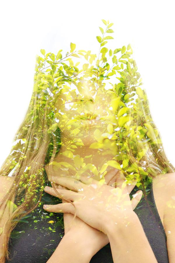 Double exposure portrait of a young natural beauty combined with tree branches and leaves stock photos