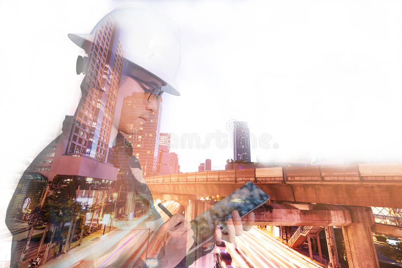 Double exposure of Engineer or Architecture man in working shir stock photography