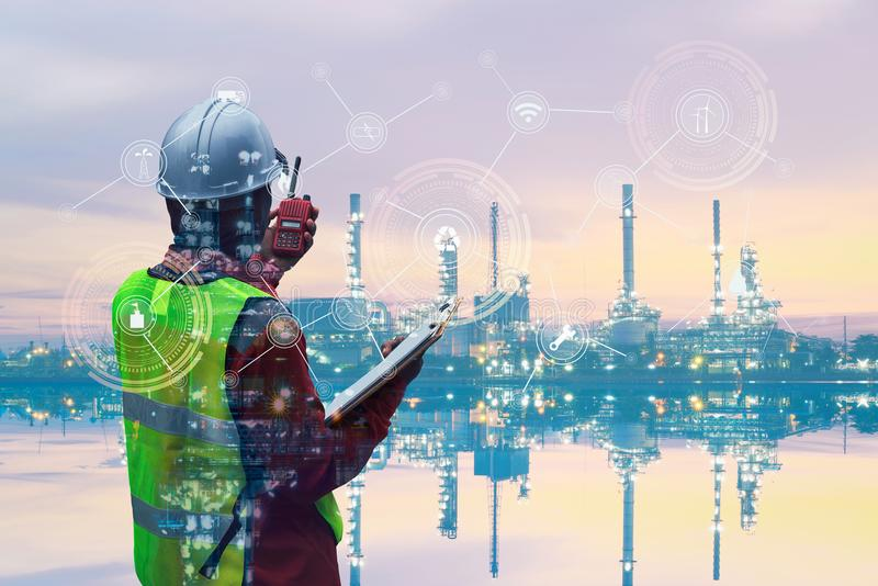 Double exposure of Engineer with oil refinery industry plant stock photography