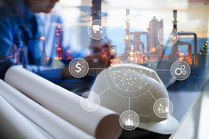 Double exposure of Engineer with oil refinery industry plant background, industrial instruments in the factory and physical system stock images