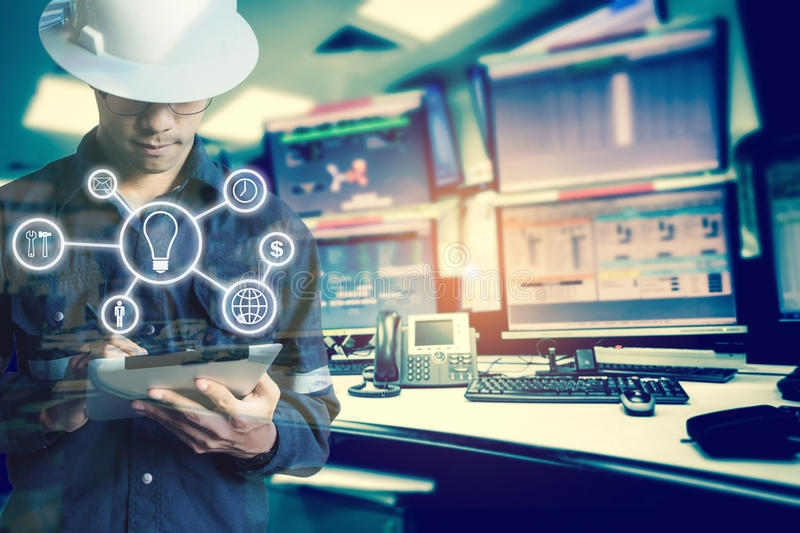 Double exposure of Engineer or Technician man with business industrial tool icons while using tablet with monitor of computers royalty free stock photos