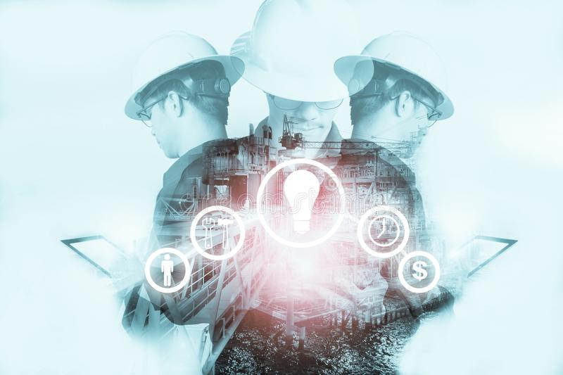 Double exposure of Engineer or Technician man with industry tool royalty free stock photo