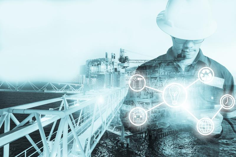 Double exposure of Engineer or Technician man with industry tool stock image