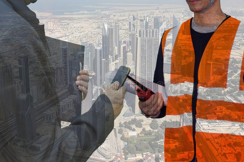 Double exposure engineering hand holding portable radio and process flow diagram for construction,asian engineer monitoring site stock photos