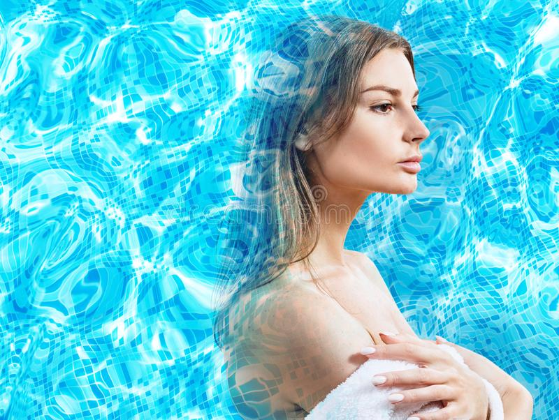 Double exposure of female face and water pool ripple. stock photos