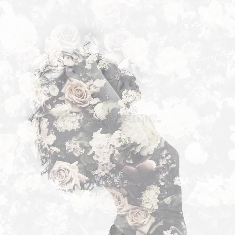 Double exposure with female portrait and vintage flower pattern stock image