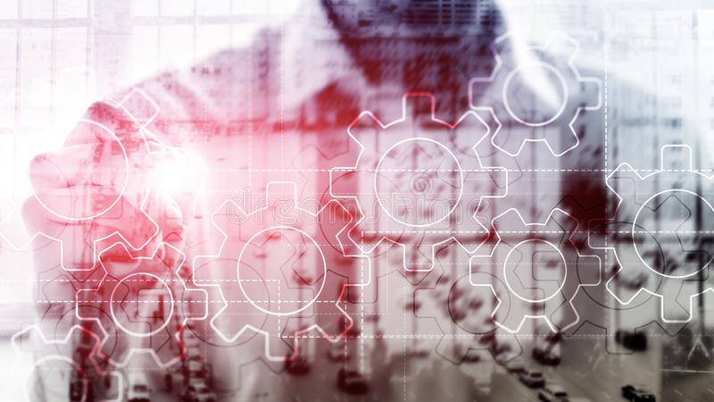 Double exposure gears mechanism on blurred background. Business and industrial process automation concept. Double exposure gears mechanism on blurred background stock images