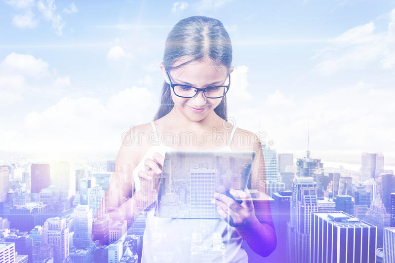 Double exposure girl city. Student using digital tablet skyline view stock photography