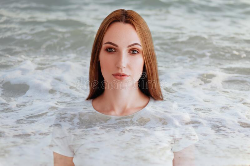 Double exposure of girl profile portrait and sea royalty free stock images