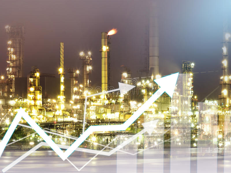 Double exposure graph economy and construction industry oil refinery background. For economy investment finance and banking concept royalty free stock photos