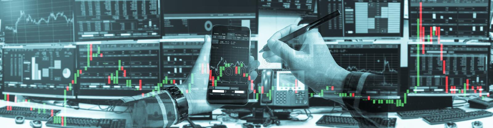 Double exposure of hand of business man using smartphone with stock trading room and stock trading chart background for investment. Business concept stock image