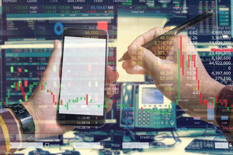 Double exposure of hand of business man using smartphone with stock trading room and stock trading chart background for investment. Business concept stock photo