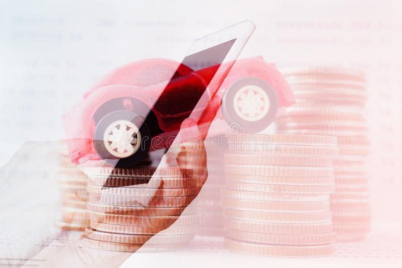 Double exposure of hand with mobile and car on stack of coins ,business and finance background stock photos