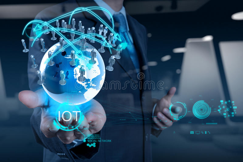 Double exposure of hand showing Internet of things (IoT) stock images