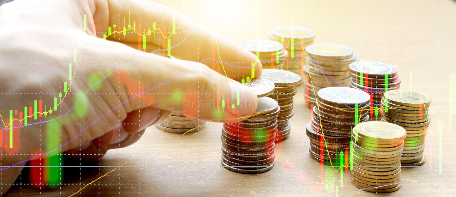 Double exposure of Hand use Coins of thailand and stock market o royalty free stock photos