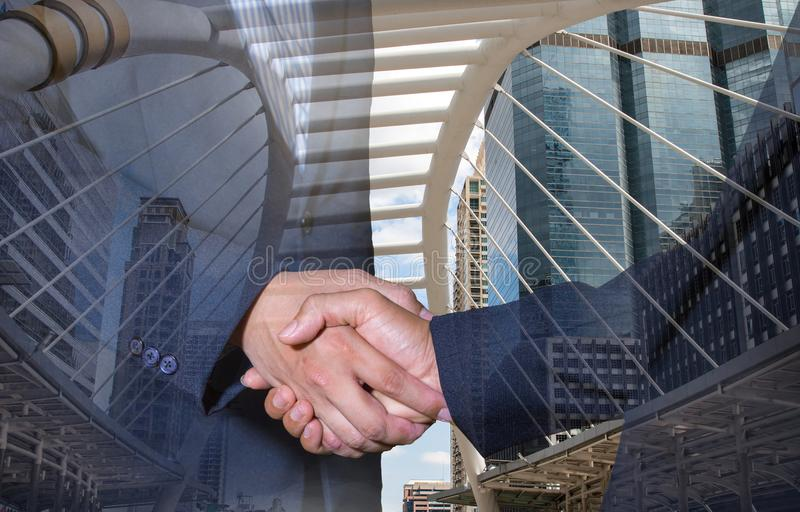Double exposure of handshake and city.handshake and business people concepts. royalty free stock images