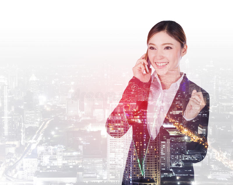Double exposure of happy business woman talking on smartphone wi royalty free stock photos