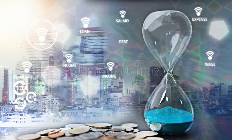 Double exposure of hourglass with coins for time stock images