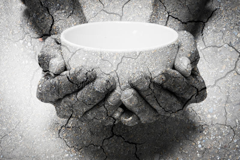 Double exposure hunger begging hands and dry soil royalty free stock photo