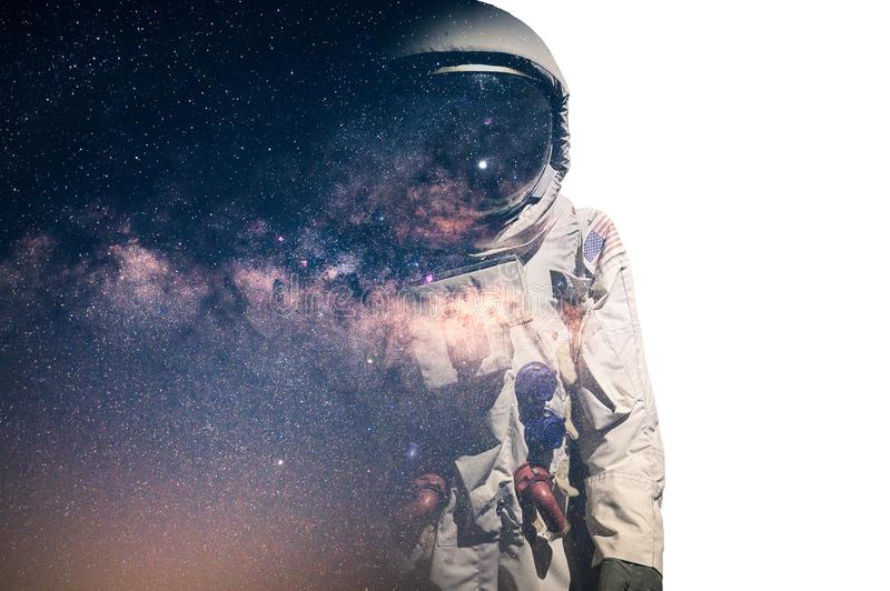 The double exposure image of the astronaut`s suit overlay with the milky way galaxy image. the concept of imagination, technology,. Future, and gaming royalty free stock photos