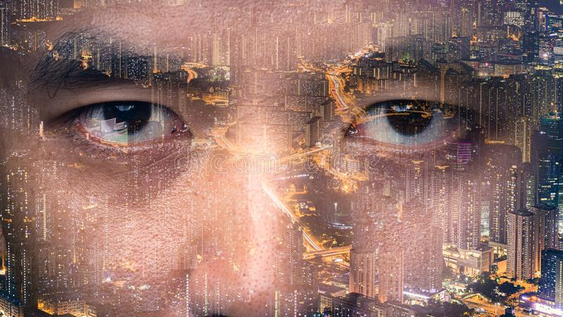 The double exposure image of the businessman`s eye overlay with cityscape image. The concept of modern life, futuristic, technolog stock image