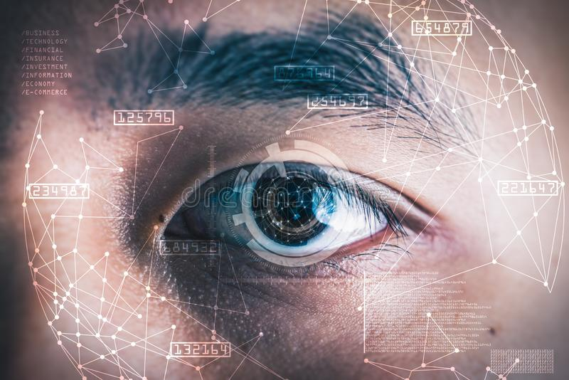The double exposure image of the businessman`s eye overlay with futuristic hologram. The concept of modern life, futuristic, technology, iris scanner and stock photo
