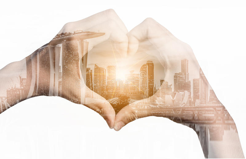 Double exposure image of girl hands in shape of love heart royalty free stock photo