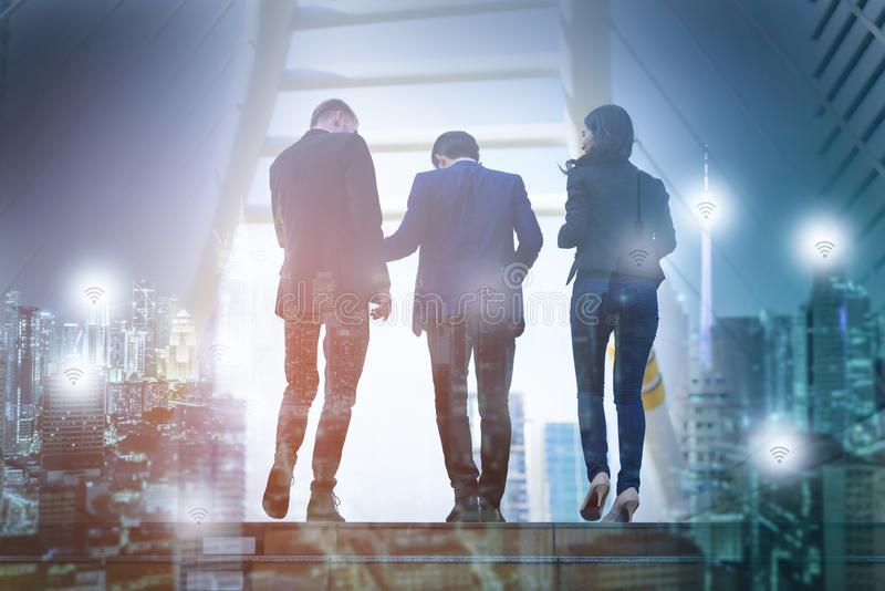 Double exposure image of Rear view of business team climbing sta stock images