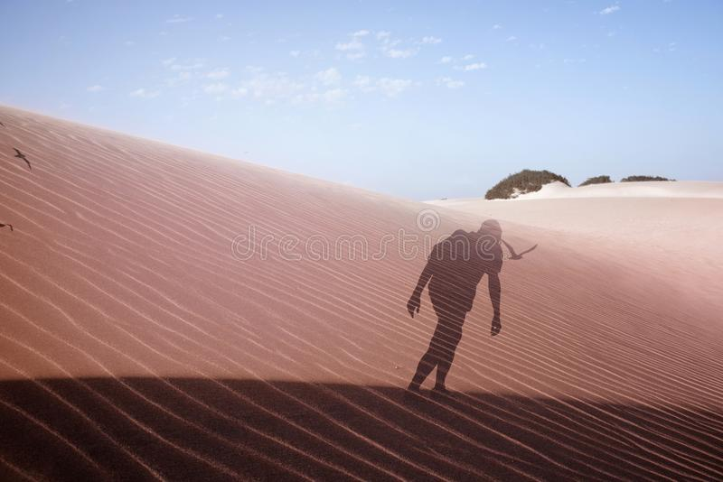 Double exposure of a man in the desert stock image