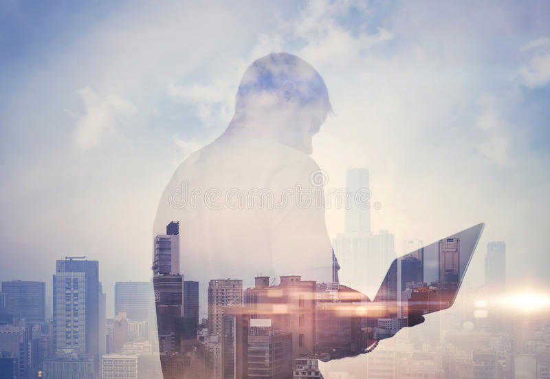 Double exposure of man with laptop and royalty free stock photos
