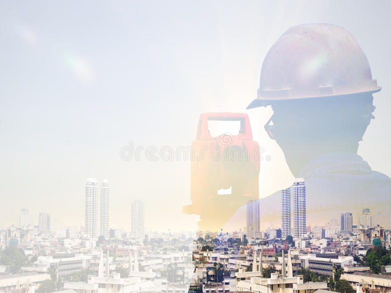 Double exposure man survey and civil engineer stand on ground working in a land building site over Blurred construction worker on. Construction site royalty free stock photography