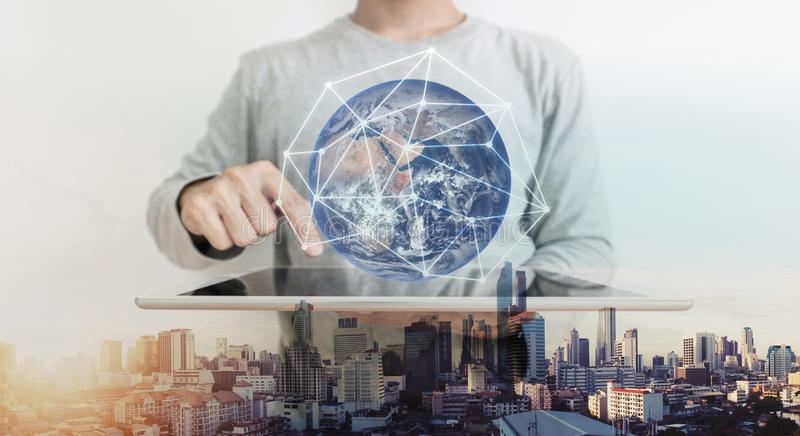Double exposure, a man working on digital tablet and global network connection hologram technology. Element of this image are furn. Double-exposure, a man stock photo