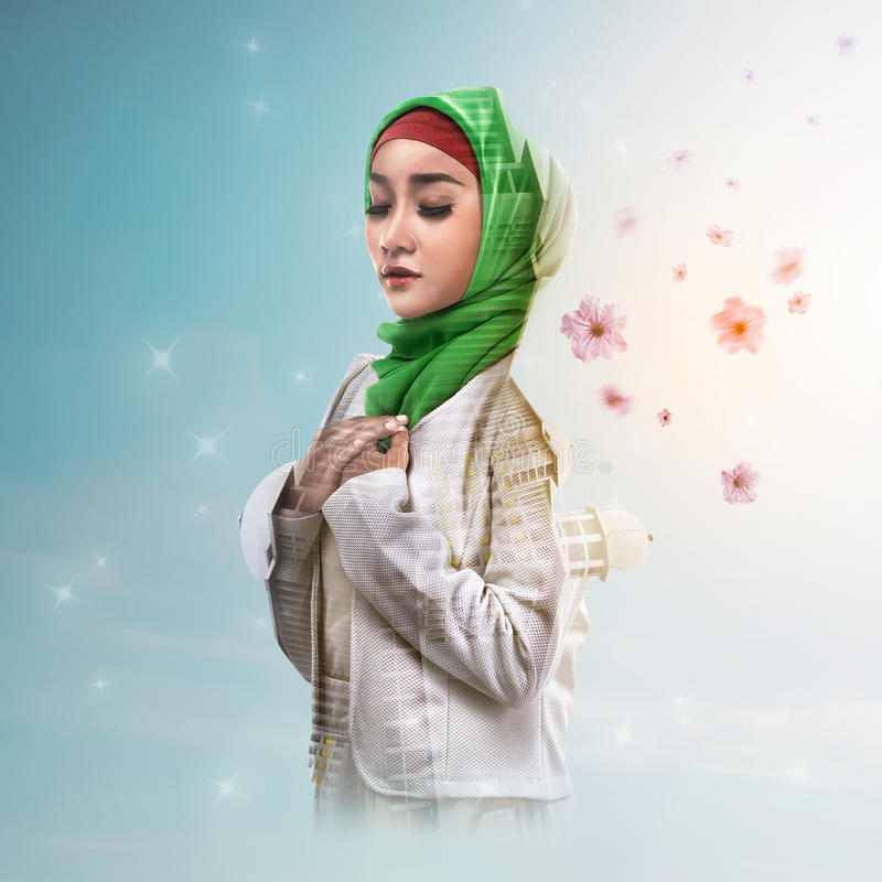 Double exposure muslim woman with mosque and flower royalty free stock images