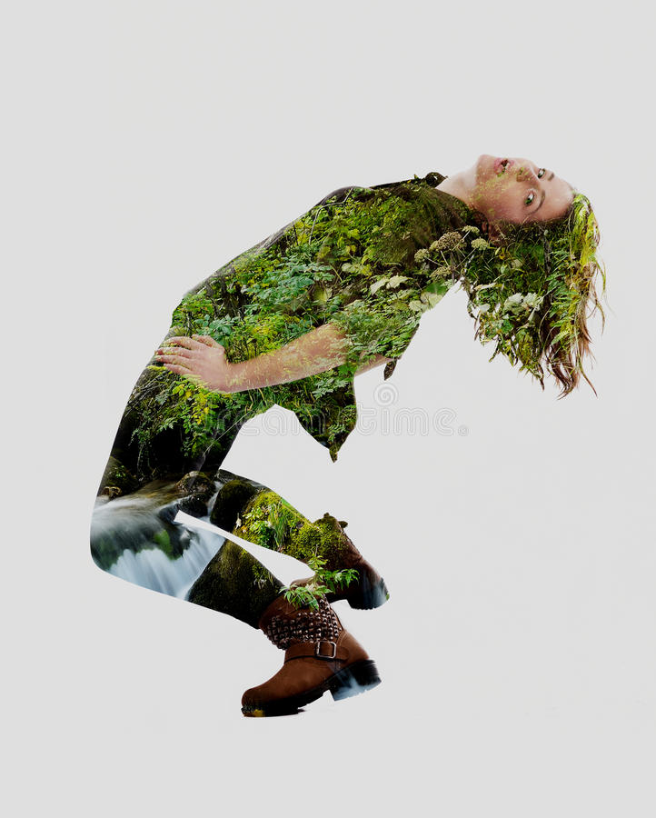 Double exposure of nature and young woman dancing stock photos