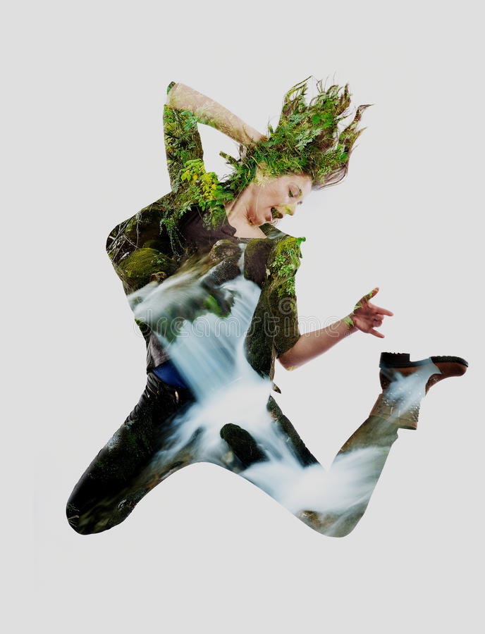 Double exposure of nature and young woman dancing royalty free stock photos